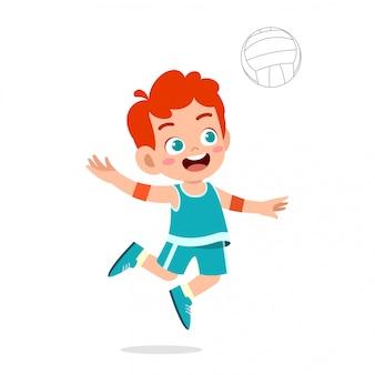 幸せなかわいい子供男の子プレイバレーボール