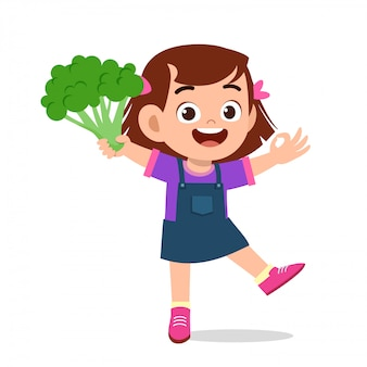 新鮮な野菜を持って幸せなかわいい子供女の子