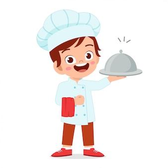 Счастливый милый малыш мальчик в костюме шеф-повара