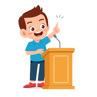 表彰台で幸せなかわいい子供男の子スピーチ
