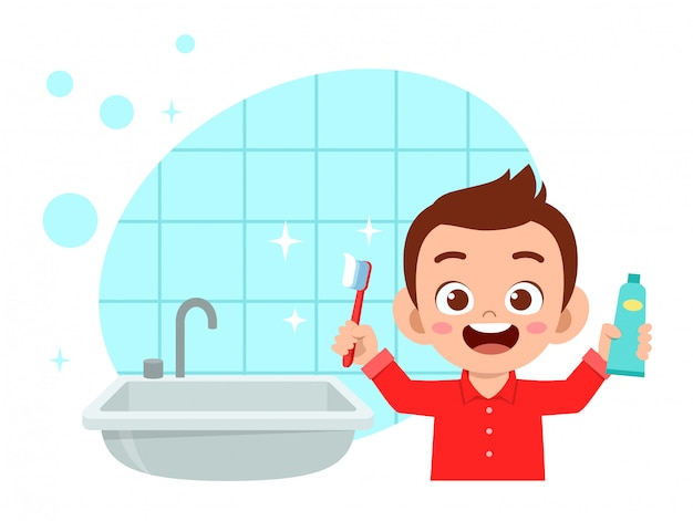 幸せなかわいい子供男の子ブラシきれいな歯