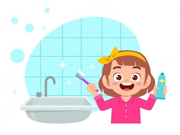 幸せなかわいい子供女の子ブラシきれいな歯