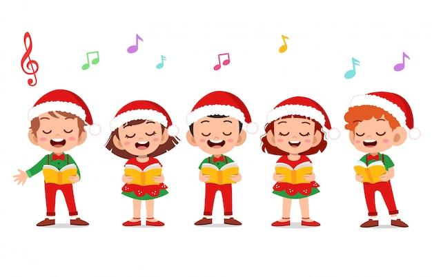 幸せな子供のクリスマス歌うミュージカル