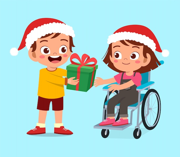 無効になっている幸せな友人が子供のクリスマスにプレゼントを与える