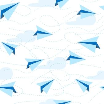紙飛行機のシームレスなパターン。紙飛行機