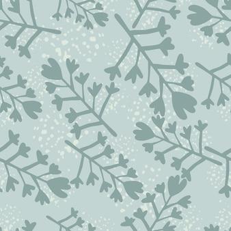 Зимний бесшовный образец в синих цветах. цветы и ветви силуэты с вкраплениями.