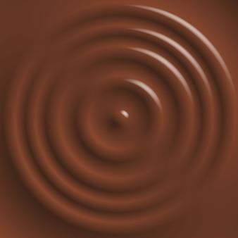 Капли падают на поверхность шоколада