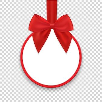 クリスマスラウンドペーパーギフトタグまたはラベルに赤いリボンと弓
