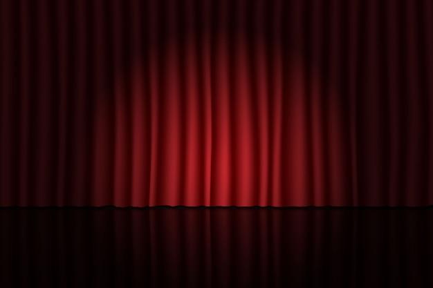 赤いカーテンとスポットライトで舞台。劇場、サーカス、映画の背景
