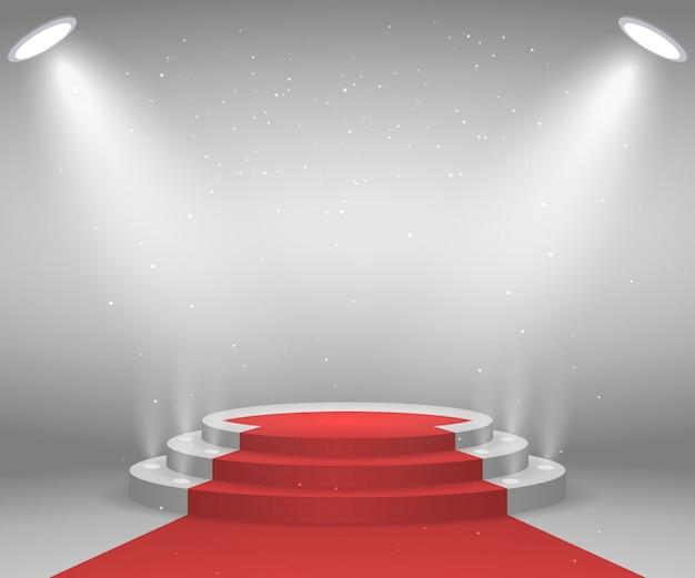 表彰式のためのライトが付いている段階。レッドカーペットで照らされたラウンド表彰台。ペデスタル。