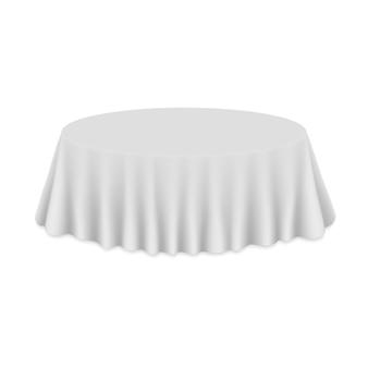 分離されたテーブルの上の空のラウンドテーブルクロス