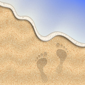 Песок пляжа с отпечатком ноги