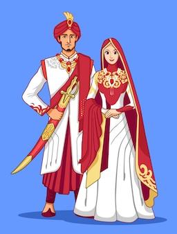 マルーンとゴールドの伝統的なドレスとパキスタンのカップル