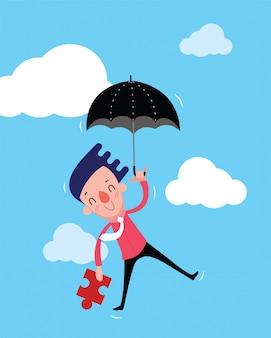 男性のビジネスマンは黒い傘とジグソーパズルを手に持って