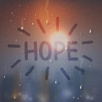 Слово надежды на составе запотевшего стекла