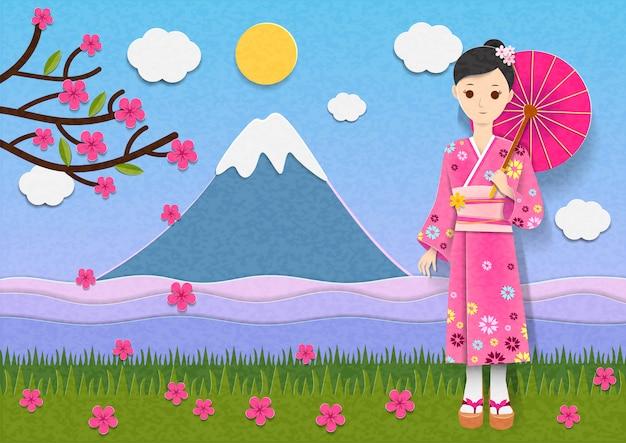 日本の着物を持つ美しい女性