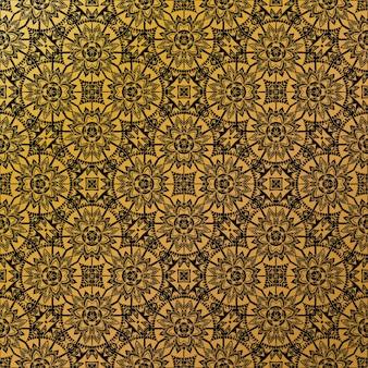 Роскошный золотой батик узор фона