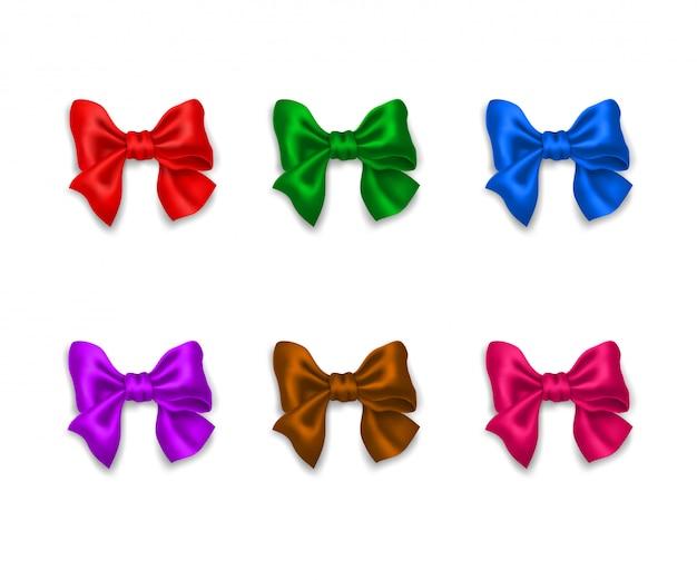 現実的な装飾的な色とりどりの光沢のあるリボン弓のコレクション。