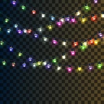 透明な上に分離されて明るいマルチカラーの花輪のセット。クリスマスのあかり。
