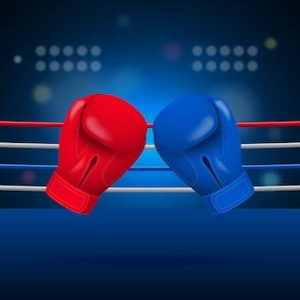 Боксерские перчатки на фоне ринга.