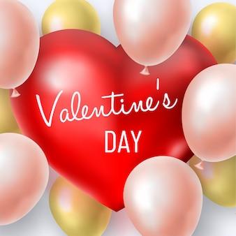 赤い大きなハートの周りのピンクと金色のインフレータブルボールとバレンタインデーの背景