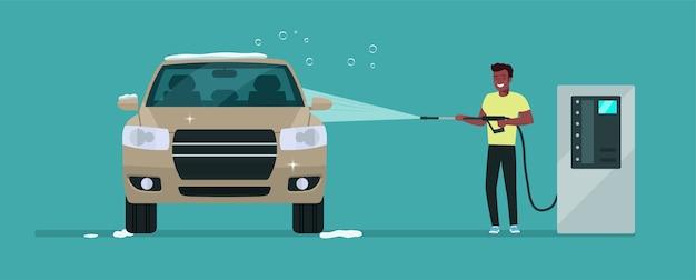 アフロマンがセルフサービス洗車で車を洗う