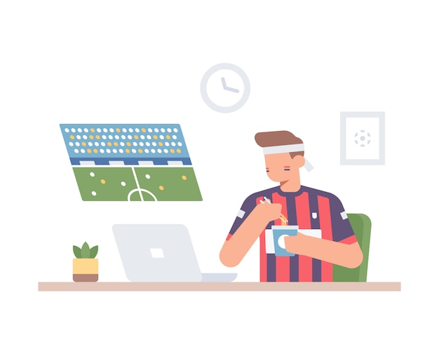 Сторонник мяча наблюдает за игрой в футбол через ноутбук во время еды чашки лапши