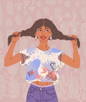 美しい幸せな女の子は舌を示しています。機嫌の良いおかしい女性が髪を抱えて、2つのおさげ髪