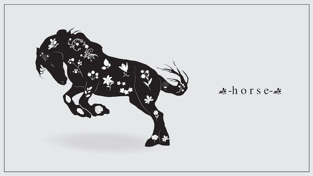白い花と植物を持つ黒い馬。