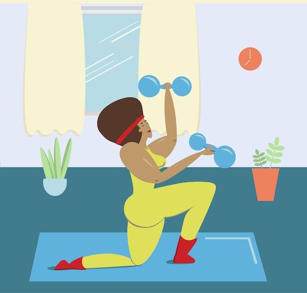 黒人女性が自宅でスポーツをしているアフリカ系アメリカ人の女性がダンベルを手に持って婚約しています...