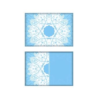 Синяя открытка с белым орнаментом мандалы, подготовленная для типографии.