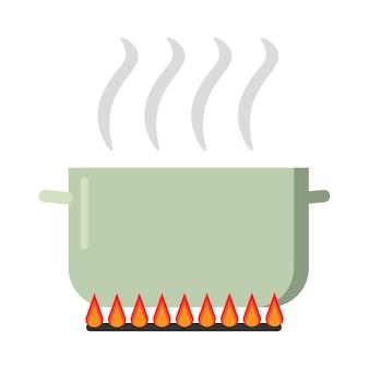 가스 스토브에 손잡이가 달린 끓는 녹색 냄비. 수프가 끓고 있습니다.