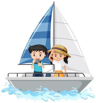 白い背景で隔離の帆船に立っている男の子と女の子