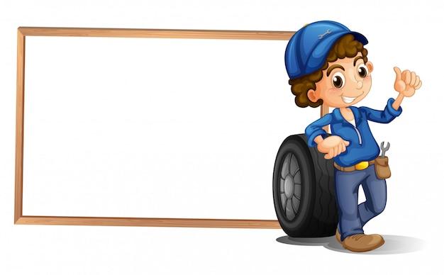 空のフレームの横にある少年とタイヤ