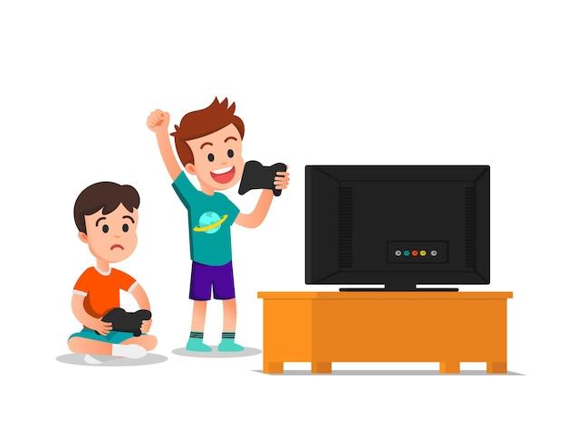 Мальчик и его друг играют в видеоигры