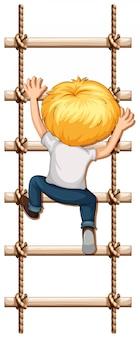 Мальчик лазает по веревке