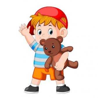 テディベアと男の子の面白い遊び