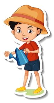 じょうろ漫画のキャラクターステッカーを持っている少年