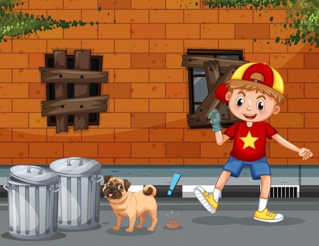 少年が犬の糞を拾う