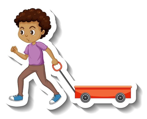 白い背景に赤いワゴンを引っ張る少年