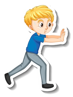 ポーズ漫画のキャラクターステッカーを押す少年