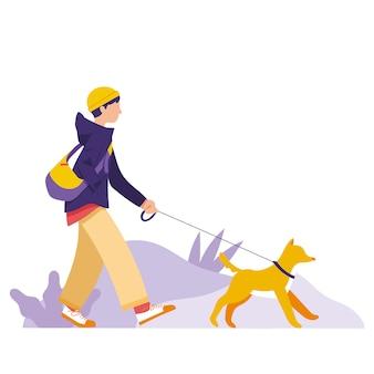 少年は公園を歩いて彼の犬を取ります