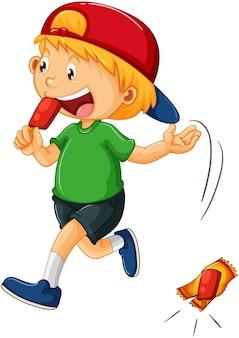 地面の漫画のキャラクターにゴミを投げる少年