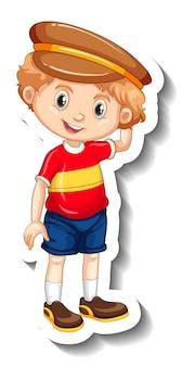 帽子の漫画のキャラクターのステッカーを身に着けている少年