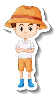少年は帽子をかぶって、漫画のキャラクターのステッカーをブーツします