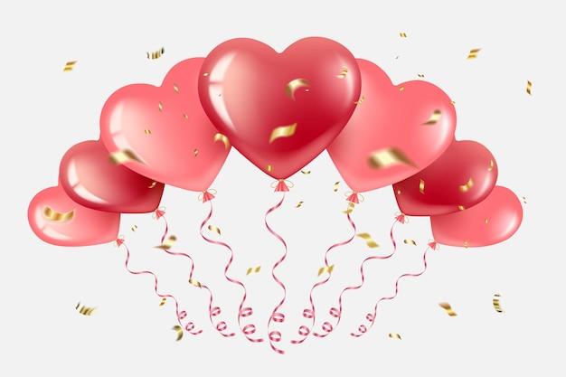 赤とピンクのハート型の風船の束。金色の紙吹雪と蛇紋石で、さまざまな方向に飛んでいます。バレンタインデーに