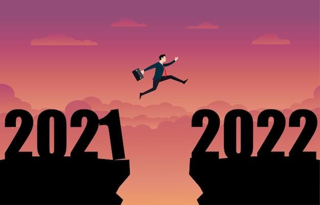 2022年の新年にジャンプするビジネスパーソン。ビジネスマンは崖のギャップを飛び越えて、困難を克服します。ビジネスコンセプト。リーダーシップ、目標、達成、成功。シルエットベクトルイラストフラット