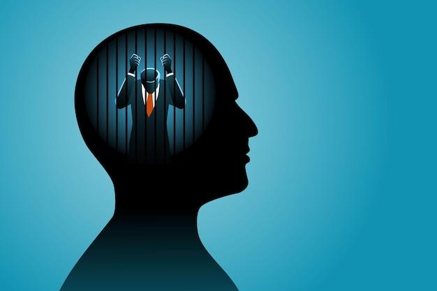 Бизнесмен в человеческой голове сидит в тюрьме