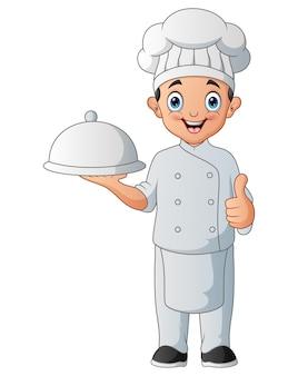 大皿を持っている漫画の幸せなシェフ