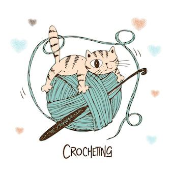 毛糸の玉に乗った猫。